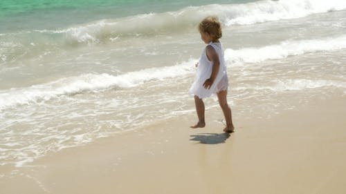 Young Little Girl Meets Open Water