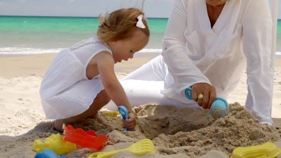 Thumbnail for Little Girl Digging In Golden Beach Sand