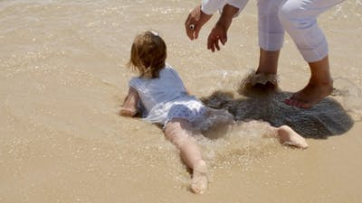 Little Girl Paddling In The Surf