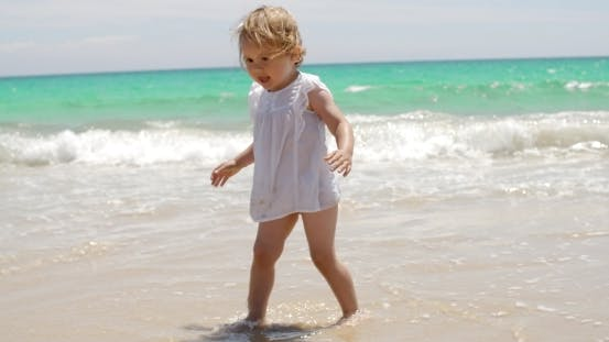 Thumbnail for Adorable Little Girl Playing In The Surf