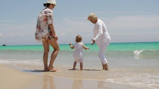 Thumbnail for Girl Enjoying At The Beach With Mom And Grandma