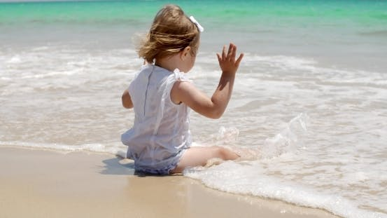 Thumbnail for Cute Baby Girl Sitting On The Beach