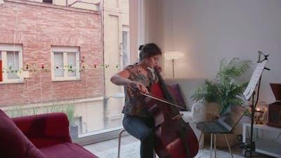 Woman Giving a cello online remote lesson