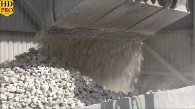 A Bulldozer Transferring Limestones