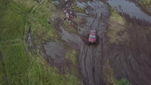 Festival of Off-road Lovers. SUVs Drive the Swamp. Cars Skid in the Mud.
