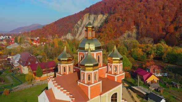 Cover Image for Aerial Drone Video of Orthodox Church with Gilded Domes in Yaremche in Carpathians Mountains