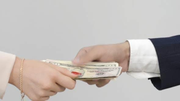 Thumbnail for Businesswoman Giving Money, Dollars