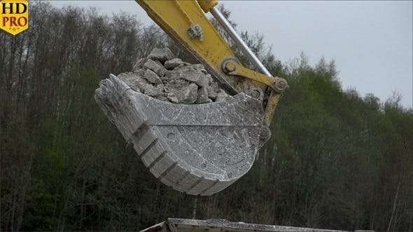 Thumbnail for A Backhoe s Head with Stones