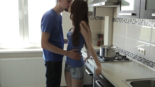 Thumbnail for Couple Kissing At Kitchen
