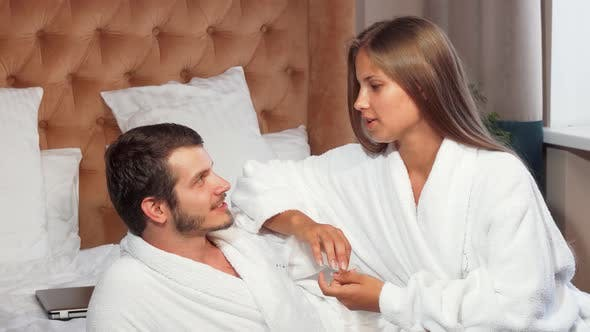 Thumbnail for Beautiful Couple Relaxing Together in Bed, Wearing Bathrobes