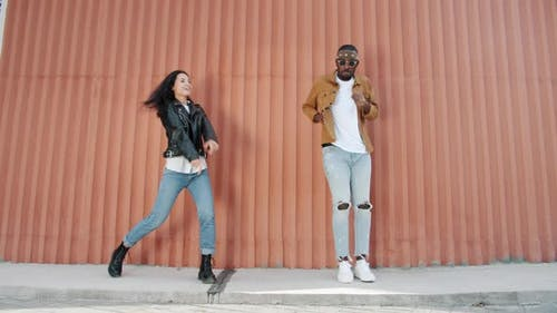 Slow Motion of Cheerful Dancers AfroAmerican and Caucasian Performing Outdoors
