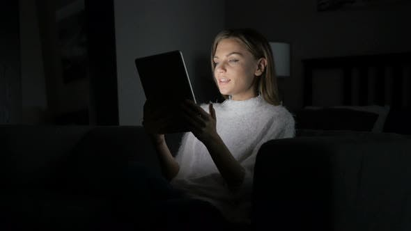 Thumbnail for Online Video Chat at Night by Woman on Tablet PC