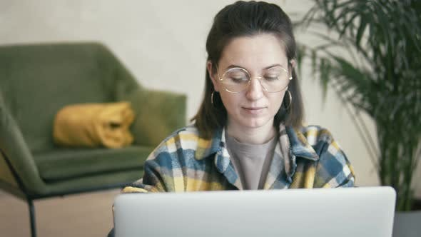 Woman Reading On Laptop