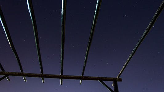 Night Sky Through Roof Terrace With Wooden Beams