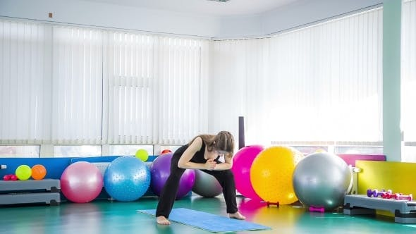 Thumbnail for Young Girl Stretching Body In The Gym