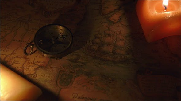 Thumbnail for Two Candles Lit Near the Map and the Compass