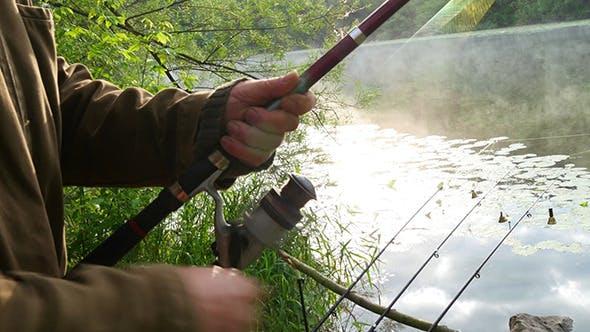 Thumbnail for Fisherman Pulls The Fishing Line On Reel