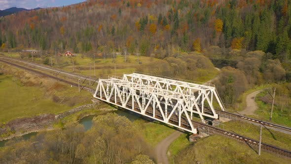 Thumbnail for View From the Height on the Autumn Mountain Landscape - Yellow Forest, River, Railway Bridge and and