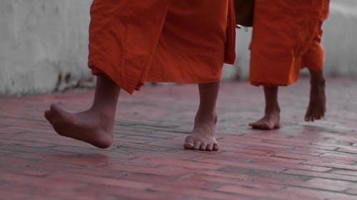 Feet Of Monks Walking