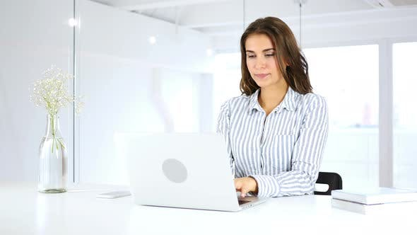 Thumbnail for Serious Hispanic Woman Busy Working On Laptop in Office