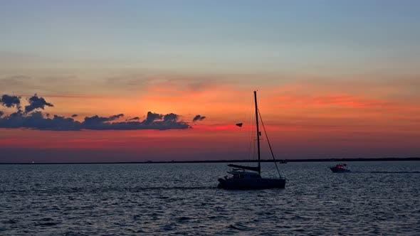 Holiday Lifestyle Landscape with Skyline Yacht Sailing Against Sunset Sailboat Tourism Maritime