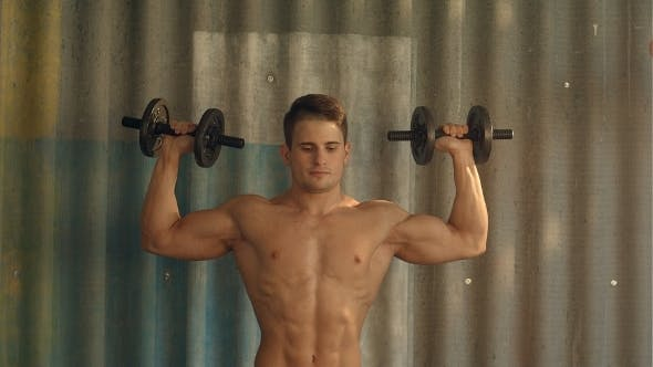 Thumbnail for Muscular Guy Doing Exercises With Dumbbells