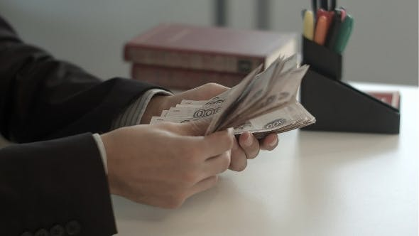 Thumbnail for Man Counts Money
