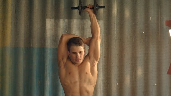 Thumbnail for Fit Muscular Man Uses His Dumbbell To Work His