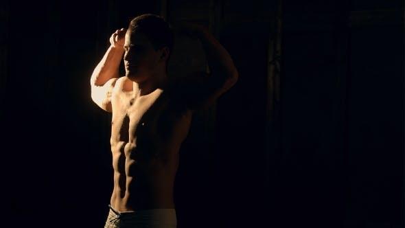 Thumbnail for Muscular Man Bodybuilder. Man Posing On a Black