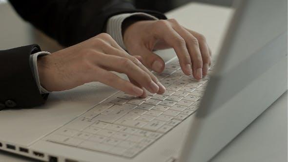Thumbnail for Man Typing On Laptop Computer Keyboard