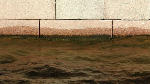 Water Level And A Stone Embankment