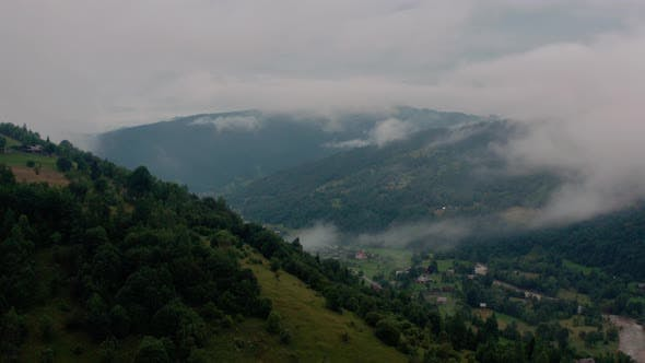 Cover Image for Aerial View Over Foggy Mountains After Rain