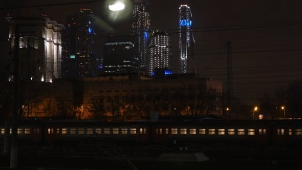 Thumbnail for Passenger Train Passing Through The City At Night