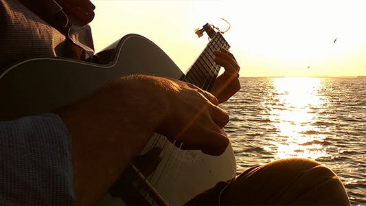Thumbnail for Playing Guitar at Sunset 2