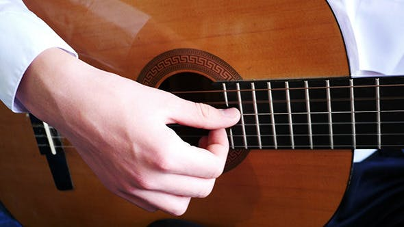 Young Man Playing A Guitar Solo
