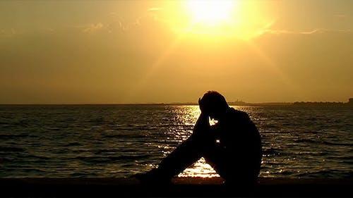 Depressed Man at Seaside