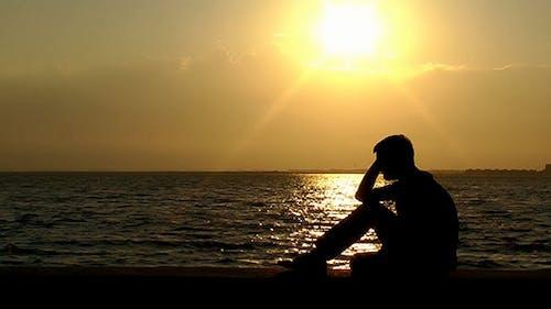 Sad Man at Seaside