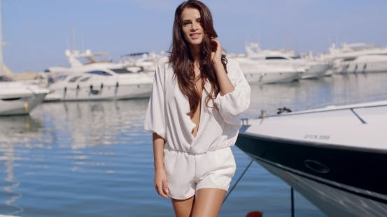 Cover Image for Portrait Of Brunette Woman On Marina Dock