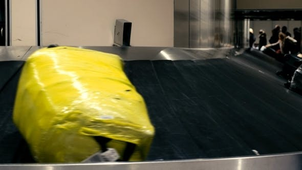 Luggage On The Conveyor Belt