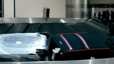 Travel Bags On The Conveyor Belt At Airport