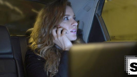 Thumbnail for Businesswoman In Car Talking On The Phone