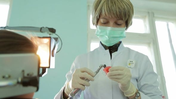Thumbnail for Orthodontist Filing Braces For Crooked Teeth With