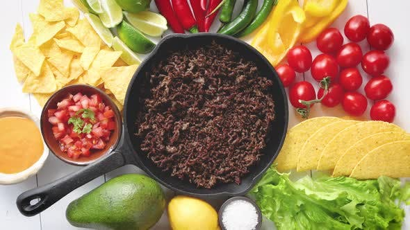Thumbnail for Ingredients for Chili Con Carne in Frying Iron Pan on White Wooden Table