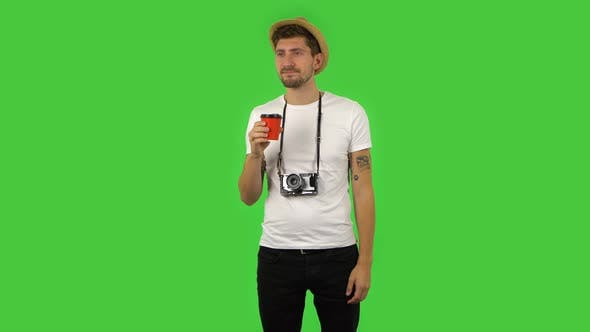 Cover Image for Confident Guy Is Enjoying Coffee, Green Screen