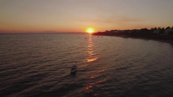 Thumbnail for Aerial Sunset Scene of Sea with Boats and Resort on the Coast, Greece