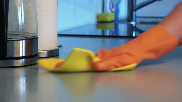 Thumbnail for A Man with Rubber Gloves Cleans a Kitchen Counter with a Cloth - Closeup