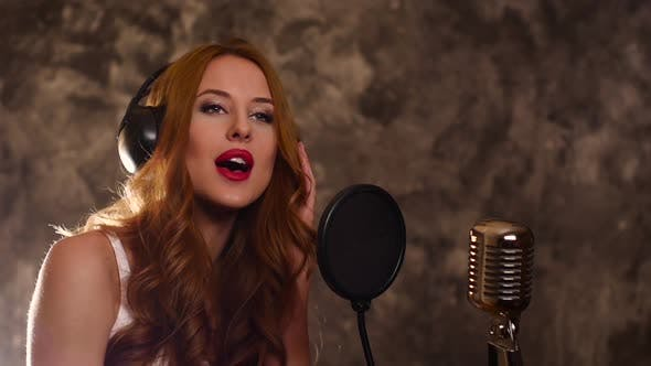 Thumbnail for Attractive Brunette Woman Recording a Song in Music Studio,slow Motion, Close Up