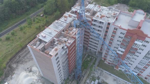 Thumbnail for Aerial view of a crane and apartment blocks