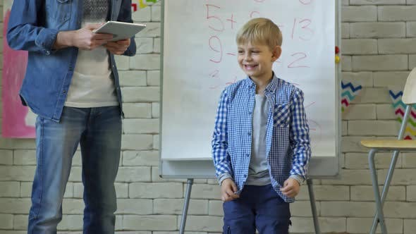 Thumbnail for Little Blonde Boy Talking at Kindergarten Lesson