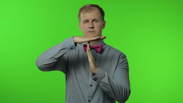 Thumbnail for Man Showing Time Out Sign. This Is Limit, Enough Gesture. Portrait of Guy on Chroma Key Background
